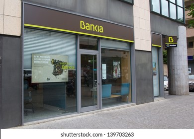 SEVILLE, SPAIN - MAY 15: A Bankia bank branch on May 15, 2013 in Seville, Spain.  Bankia must close branches under the terms of the largest bank bailout, 24.5 billion euros, in Spain�s history.