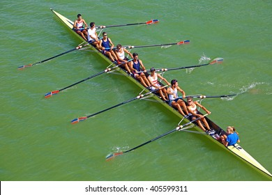 Seville, Spain - May 2014: training of an eight on river Guadalquivir. The rowers are men and the cox is a woman.