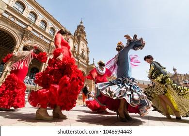 SEVILLE, SPAIN - MAY 2017: Young women dance flamenco on Plaza de Espana