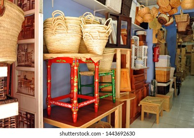 Seville, Spain - May 21, 2011: Furniture, chairs, tables, wicker bags, typical Andalusian handicraft shop in a commercial street of sevilla, spain
