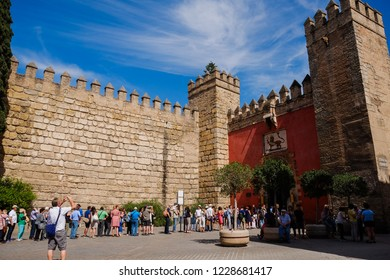 Seville, Spain. May 4, 2017 : Tourists queuing in front of the Real Alcazar of Seville.
