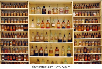 Seville, Spain - May16, 2012: Antique apothecary jars of glass with medicinal compounds on the old pharmacy shelve