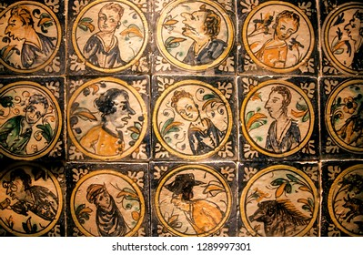 SEVILLE, SPAIN - NOV 15: Faces of historical persons on patterned ceramic tiles in traditional style, made in 18th century on November 15, 2018. Population of Sevilla is near 750,000