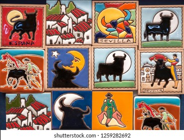SEVILLE, SPAIN - NOV 16: Shop with colorful souvenir magnets for tourists with popular symbols of Andalusia, Sevilla and corrida tradition on November 16, 2018. Population of Sevilla is near 750,000