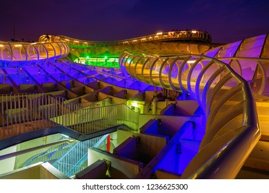 Seville, Spain - November 13, 2018: Metropol Parasol with unidentified people at night. It is a wooden structure designed by Juergen Mayer, with dimensions 150 by 70 meters and 26 meters high