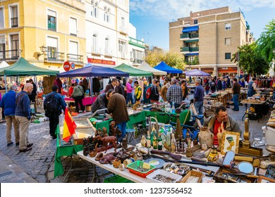 Seville, Spain - November 13, 2018: street flea market with unidentified people in Seville. Seville is the capital of Andalusia and the 4th largest city in Spain