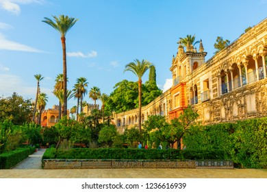 Seville, Spain - November 14, 2018: inside of the Alcazar of Seville with unidentified people. It is the oldest royal palace still in use in Europe, registered in 1987 as UNESCO World Heritage Site