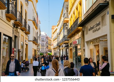 Seville, Spain - November 15, 2018: shopping street in the city center with unidentified people. Seville is the capital of Andalusia and the 4th largest city in Spain