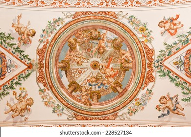 SEVILLE, SPAIN - OCTOBER 28, 2014: The fresco of angels with the insignia of pope on the ceiling in church Hospital de los Venerables Sacerdotes by Juan de Valdes Leal (1622 - 1690).