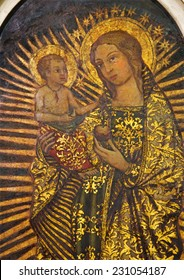 SEVILLE, SPAIN - OCTOBER 29, 2014: The paint of Madonna from 16. cent in church Iglesia San Idefonso by unknown painter.