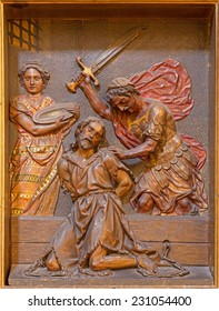 SEVILLE, SPAIN - OCTOBER 29, 2014: The carved polychrome relief of decapitation of  St. John the Baptist in church Iglesia de la Anunciacion by Martinez Montanes from 18. cent.