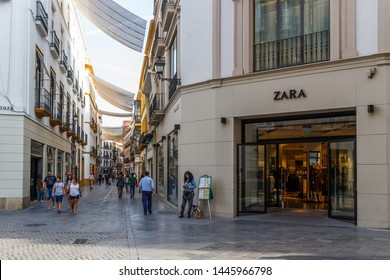 Seville, Spain - September 3rd 2015: Shopping street with a Zara store. Zara is the main brand of the Inditex group