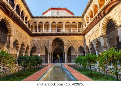 Seville / Spain: Tourists in the yard of Real Alcazar Royal Palace - March 2019