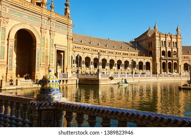 Seville, Spain-12 21 2015:People are doing rowboat on the Plaza de España, which is a square in the Parque de María Luisa, in Seville, Spain.Built in 1928 for the Ibero-American Exposition of 1929.