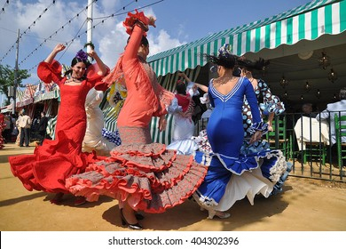 SEVILLE, SPAIN-MAY 4: Women dressed in flamenco dancing in Seville Fair. on May 4, 2011 in Seville