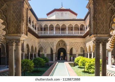 Seville,Spain-August 8,2017:People visit the Royal Alcazar of Seville during a sunny day.