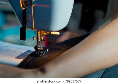 sew machine closeup hand