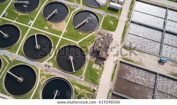 Sewage Farm: Aerial drone photo looking down onto a wide angle view of a waste water treatment processing plant in North London.