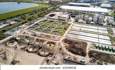 Sewage Farm: Aerial view of a waste water treatment processing plant, or sewage farm, and surrounding industrial estate in North London.