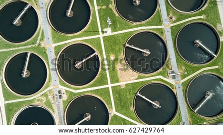 Sewage Farm: Static aerial photo looking down onto the clarifying tanks of a UK sewage farm in North London providing an abstract geometric background texture.