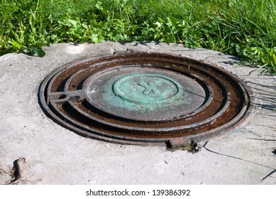sewage hatch on green grass