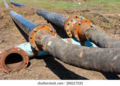 Sewage pumping station accident environmental man-made disaster. Repair broken old rusty pipes in open waste water flooded trenches