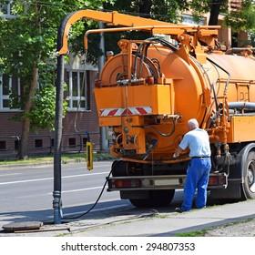Sewage truck on the street