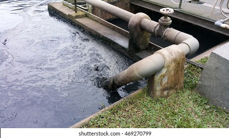 Sewage water rushes out from a fixed pipe at various time intervals into the oxidation ditch found in a treatment plant.