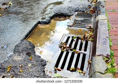Sewer drain on the road in Israel. Rainwater runoff in an Israeli city