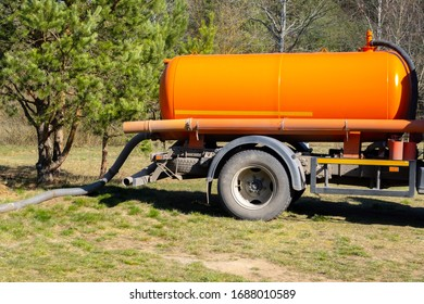 Sewer tank truck providing cleaning service outdoor. Specialized car, sewage pumping machine