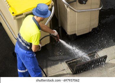 sewerage worker cleaning sewer line