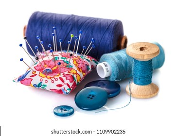 Sewing accessories close-up on white isolated background