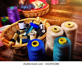 Sewing accessories coil threads and measuring tape in basket supplies close up. Learning to sew at home.
