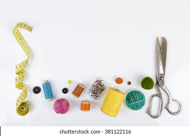 sewing accessories with copy space on white
