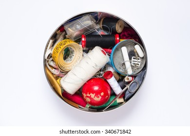 Sewing accessories round box on a white background
