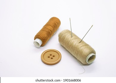 Sewing accessories. Threads, needles, buttons. Close-up. White background. Hobby. Needlework. Sewing