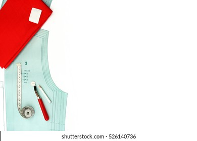 Sewing background. Copyspace with paper pattern, sewing tools and accessories
