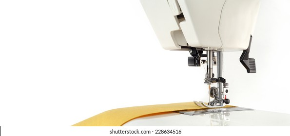 Sewing background. Sewing machine and fabric on a white background.