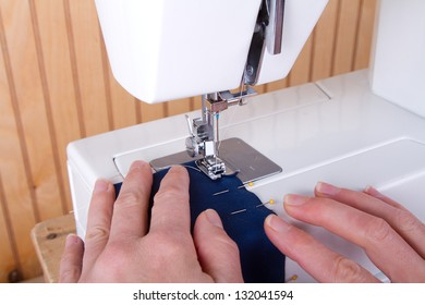 Sewing blue fabric on sewing machine