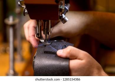 Sewing a box stitch pattern on black leather