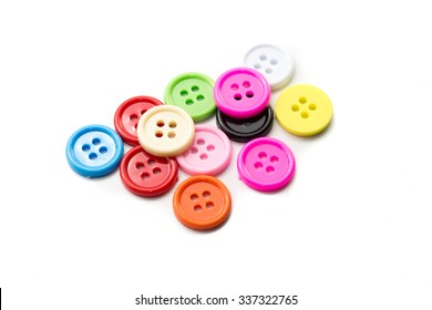 Sewing buttons on white background, Plastic buttons, Colorful buttons, Clasper close up, buttons