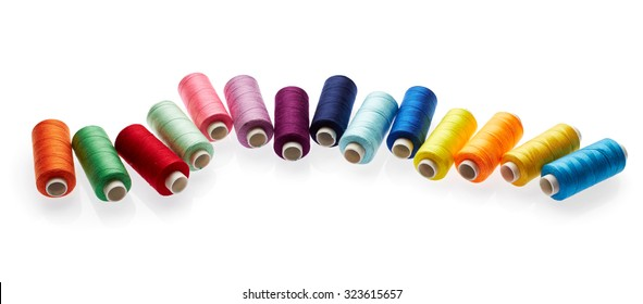 Sewing colored threads isolated on white background