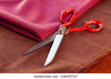 Sewing equipment composition on the table: scissors, fabric. Fashion designers studio
