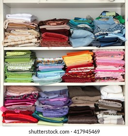 Sewing Fabrics are in the closet. Colored fabric. Cabinet needlewoman. Women's domestic interests.