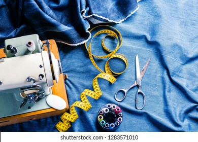 sewing indigo denim jeans with sewing machine, garment industrial concept