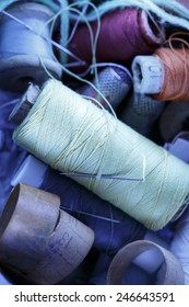 Sewing items with needle all in a heap