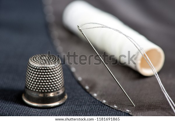 Sewing kit on the gray mans jacket