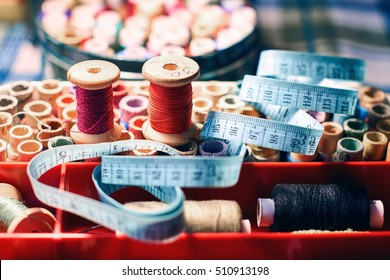 Sewing kit on the table: tape measure, accessories and equipment for needlework