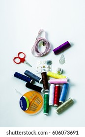 Sewing kit: scissors, measuring tape, thimbles, threads and buttons