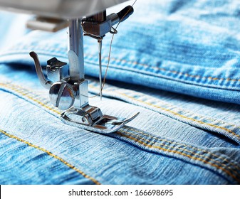 Sewing machine and blue jeans fabric.